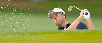 Marc Leishman blasts out of a bunker on the 17th hole on his way to shooting six under in the opening round of the Masters Tournament at Augusta National Golf Club in Augusta, Georgia, Thursday, April 11, 2013. (Jeff Siner/Charlotte Observer/MCT)