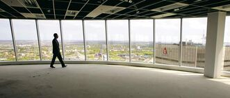 Alan Dunnett admires the view from his company's new digs on the top three floors and part of another floor in 201 Portage, formerly home to Canwest Global Communications.
