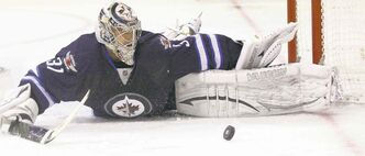 Ondrej Pavelec splays out to make a spectacular save in the third period Friday night. The Jets netminder was often brilliant in a 5-0 Winnipeg win over Nashville.
