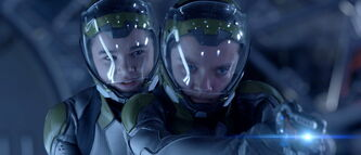 "Hailee Steinfeld, left, and Asa Butterfield in a scene from ""Ender's Game."""