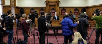 Chief Justice Glenn Joyal talks to the media about the