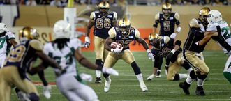 Running back Nic Grigsby (32) broke out against Toronto with 122 yards rushing in the season opener, but the entire Bombers run game has struggled since. Against the Riders (above), Grigsby ran for seven yards.