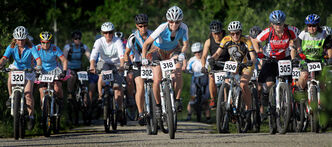 Jane Braun (No. 318) led the way at the start of Wednesday's mountain bike race at Birds Hill Park.