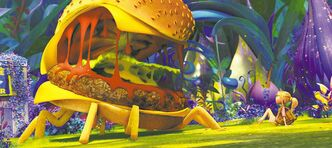 Open wide and say... wha? Sam (Anna Faris) gets a gooey welcome from a Cheespider in Cloudy With a Chance of Meatballs 2.
