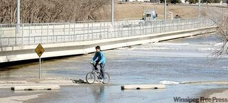 The Red River was almost touching the bottom of the12th Avenue North toll bridge in Fargo Monday afternoon.