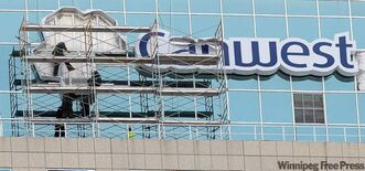 The Canwest sign and logo is removed Monday afternoon from the former Canwest Place building that will now be known as 201 Portage.