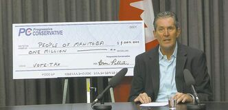 Brian Pallister used a giant novelty cheque to make his point. Manitobans won�t actually receive any money.