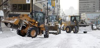 A team of loaders worked to clear Main Street at McDermot Avenue on January 12, 2013.