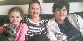 Emily Cablek (centre) with her children, Abby and Dominic Maryk.