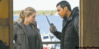 Pascale Hutton (left) and Adam Beach in Arctic Air.