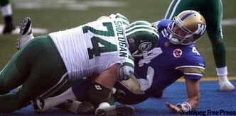 Winnipeg Blue Bomber quarterback Buck Pierce gets sacked by Saskatchewan Roughrider Keith Shologan. Sept 11. Pierce is resting bruised ribs but hopes to play against the Montreal Alouettes Sunday.