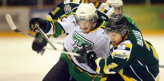 Portage Terriers Brent Wold fights his way past Humbolt Broncos' Kameron Ballas Wednesday night in ANAVET Cup action.
