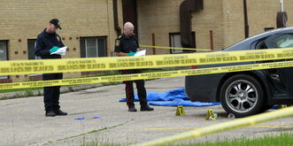 Winnipeg police gather evidence outside Kaila Tran's Clayton Drive apartment after she was fatally attacked in June 2012.