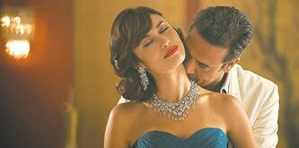 Top left, Grammer. Above, Washington stars as Olivia Pope in Scandal.  Below, Olga Kurylenko as Vera Evans and Jeffrey Dean Morgan in Magic City.
