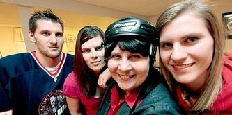 So hockey-smitten is mom Phyllis that she wears a helmet around the house.Offspring Jeff, Angie and Jenelle (from left) are likewise enchanted by the sport.