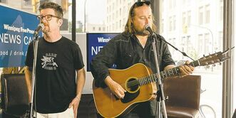 Andy Maize (left) and Josh Finlayson of the Skydiggers perform Wednesday.
