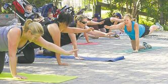 Pregnant women exercise at FortWhyte Alive in September.