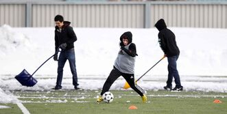Young soccer players put their cleats to the test as volunteers shovelled snow off the artificial turf during tryouts at the Winnipeg Soccer Complex Monday.