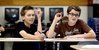Avery and Noah (right) work together on a Grade 7 class project at Windsor School.