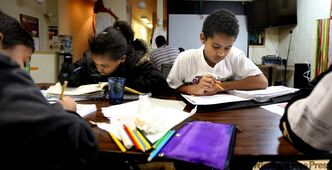 Students work with tutors in the community centre.
