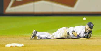New York Yankees shortstop Derek Jeter reacts after injuring himself in the 12th inning of Game 1 of the American League championship series against the Detroit Tigers early Sunday, Oct. 14, 2012, in New York. (AP Photo/Paul Sancya )