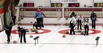 Teams Holland versus Montford (left rink) and Teams Jaggi versus Paulsen (right rink) during Sunday morning draws of the 2013 Women's Curling Classic at the Fort Rouge Curling Club.