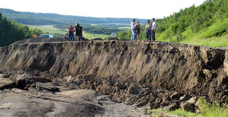 Area residents view the collapsed section of Highway 83 near Asessippi Provincial Park