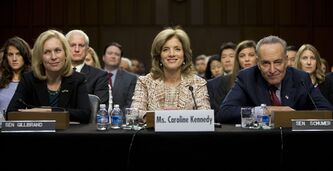 Caroline Kennedy of New York, center, flanked by Sen. Kirsten Gillibrand, D-N.Y., left, and Sen. Charles Schumer, D- N.Y., looks to members of the committee during the Senate Foreign Relations Committee hearing on her nomination for Ambassador to Japan, on Capitol Hill, Thursday, Sept. 19, 2013, in Washington. Former first daughter Caroline Kennedy said she would be humbled to carry forward her father's legacy if confirmed by the Senate to be the next U.S. ambassador to Japan. (AP Photo/Carolyn Kaster)