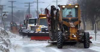 Crews remove snow from southbound St. Mary's Road on Wednesday. Mayoral candidates appear to be more interested in making statements regarding snow clearing than infrastructure or economic development.
