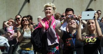 About 150 of the faithful showed up at city hall Friday at noon to listen to the mayor and others proclaim the opening of Gay Pride Week and raise the rainbow flag.