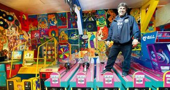 Tony Pimentel atop some of the games at Playland in Winnipeg Beach, where he met wife and co-owner Rochelle Hykawy.