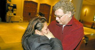 In this file photo, Epifania Austria meets with Jim Ladd, the man who received her husband's lungs in 2003, after the life-giving donation. Ladd died Thursday.
