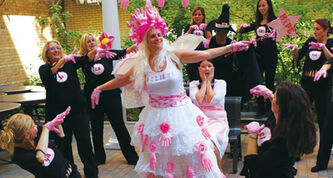 Glinda the Good Witch (centre), played by Janice LaBarre, helps Dorothy (right), played by Tracy McMillan, fight the black-clad cancer cells.