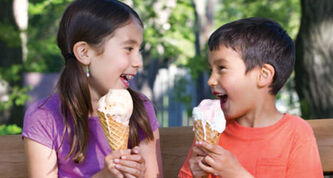 Morgan Beveridge and brother, Darcy, enjoy ice cream and gelato cones on a warm summer evening.