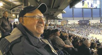 Longtime Bombers fan Stanley Halek no longer misses any calls, thanks to the club's closed caption scoreboard.
