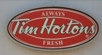 Av Tim Hortons logo is shown at an outlet in Oakville, Ont., Aug.25, 2010. The NHL all-star game is getting a title sponsor.The league says next year's contest will be known as the 2012 Tim Hortons NHL All-Star Game.THE CANADIAN PRESS/Richard Buchan