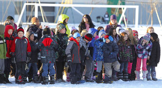 Shamrock School students watch the owl's release.