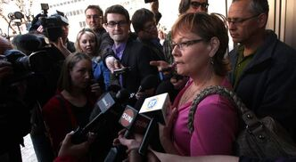 Carol de Delley, mother of slain bus passenger Tim McLean, speaks to the media after the review board hearing. She opposes giving Vince Li (below) escorted outings.