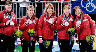 From left, Kristie Moore (alternate), Cori Bartel (lead), Carolyn Darbyshire (second), Susan O'Connor (third) and Cheryl Bernard (skip) show off their silver medals.
