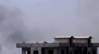 In this image taken from video obtained from the Shaam News Network, which has been authenticated based on its contents and other AP reporting, smoke rises from buildings after warplanes shell the town of Jobar, in Homs, Syria, on Thursday, Jan. 24, 2013. (AP Photo/Shaam News Network via AP video)
