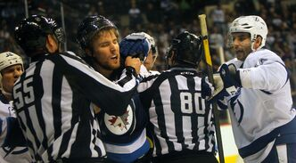 An angry Winnipeg Jet Blake Wheeler is restrained by linesman Shane Heyer in a second-period scrum Thursday at the MTS Centre.