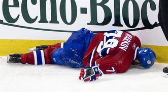 Montreal Canadiens' Andrei Markov lies on the ice injured after colliding with Carolina Hurricanes' Eric Staal during third period NHL hockey action in Montreal, Saturday, November 13, 2010. Gruesome cuts like the one that looks to have ended the season of Ottawa Senators defenceman Erik Karlsson are not new to hockey or any sport played on skates. Rearguards Kevin Bieksa of the Vancouver Canucks and Markov of the Montreal Canadiens are among those with legs sliced open by razor-sharp skates in recent seasons. THE CANADIAN PRESS/Graham Hughes