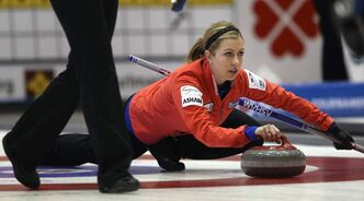 Skip Michelle Montford throws during play Thursday afternoon against team Lisa Menard at the 2012 Scotties Tournament of Hearts.