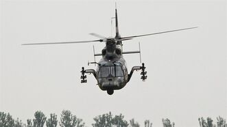 Chinese Army Z-9WZ attack helicopter, designed and manufactured by China, makes a flight demonstration on the outskirts of Beijing, China July 24, 2012. THE CANADIAN PRESS/AP, Andy Wong
