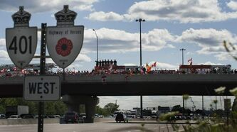 Residents of Ajax, Ont., pay respect as the hearses of Master Corporal Kristal Giesebrecht and Private Andrew Miller drive on the Highway of Heroes towards Toronto in June 2010.