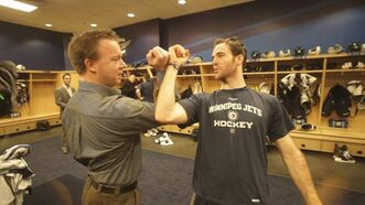 Mark Flood shows Geoff Kirbyson one of the Jets' secret handshakes.