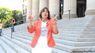 Gail Asper works on her rap moves.