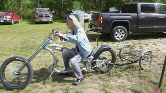 Keith Dyck sits on his custom-made bicycle on the first day of the Winnipeg Folk Festival. A woman took off with it after he left it next to his tent Saturday morning.