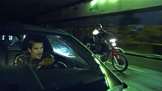 Ethan Hawke evades a motorcycle gunman with conveniently terrible aim in Getaway.