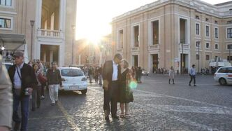 Tobasonakwu Kinew kisses his wife in St. Peter's Square the morning of Saint Kateri Tekakwitha's canonization.
